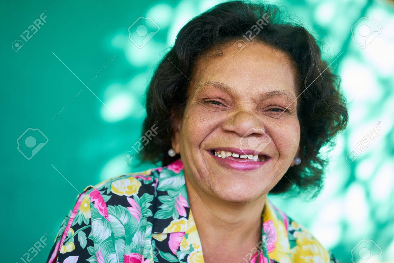 Old hispanic real people from Cuba with feelings and emotions, portrait of funny senior african american lady laughing and looking at camera. Elderly black woman smiling - 73834037