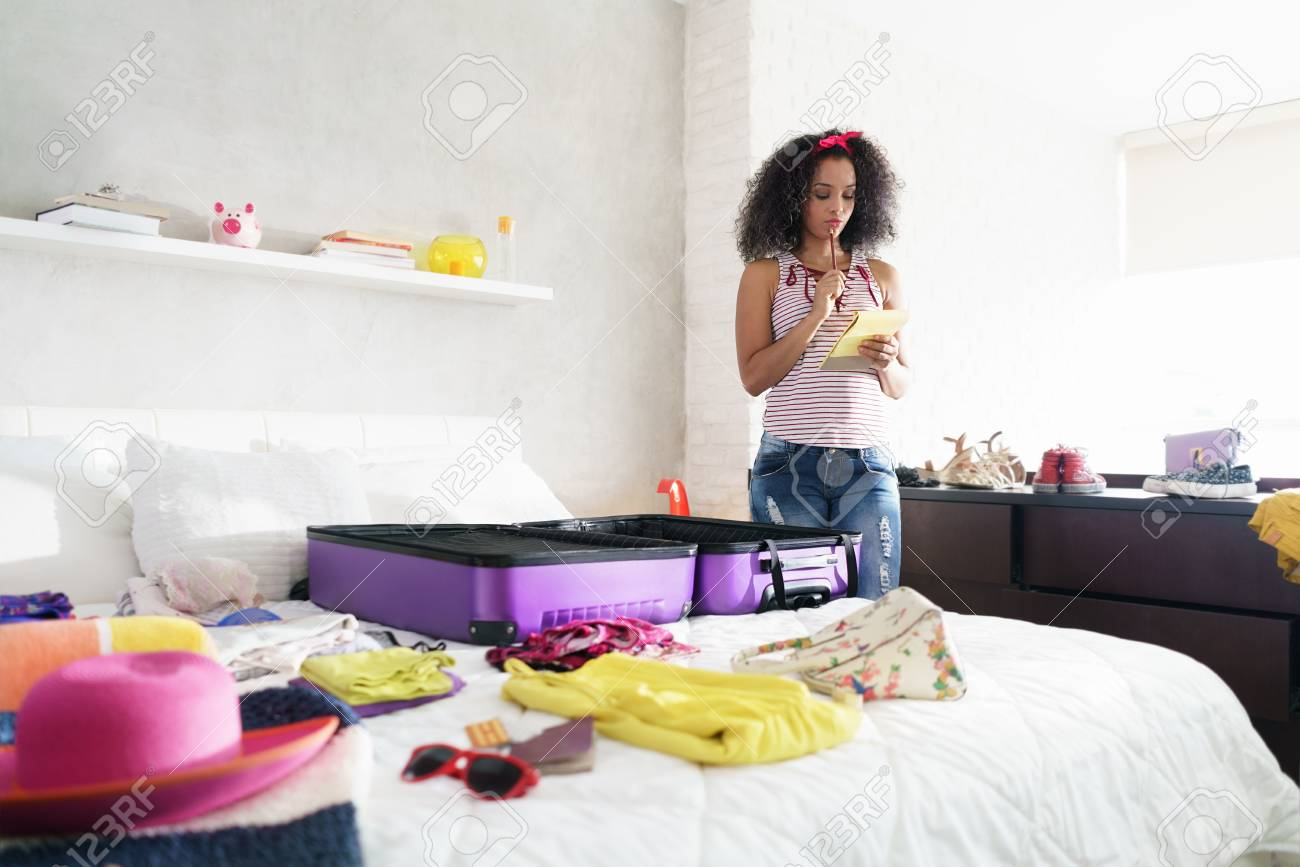 Cute African American Girl Packing Bag For Holiday And Travel - 103955712