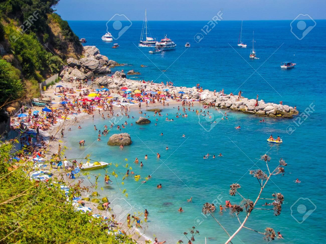 Crowded beach in Capri, Italy - 147819699