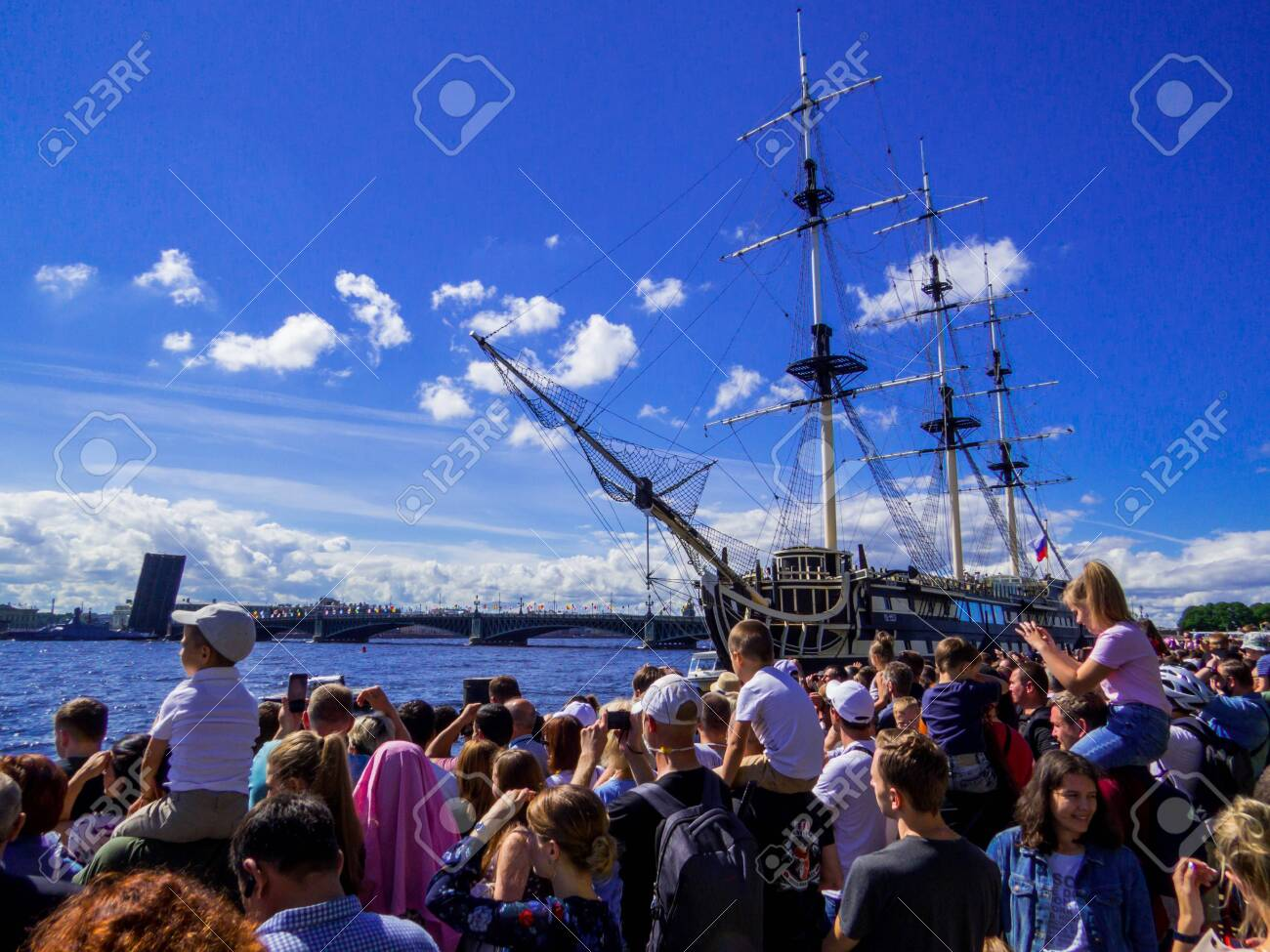 St. Petersburg, Russia - July 26, 2020: People watching the annual celebrations for the Navy Day on the embankment of the Neva River. - 152365081
