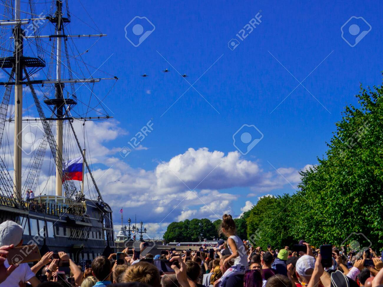 St. Petersburg, Russia - July 26, 2020: People watching the annual celebrations for the Navy Day on the embankment of the Neva River. - 152365080
