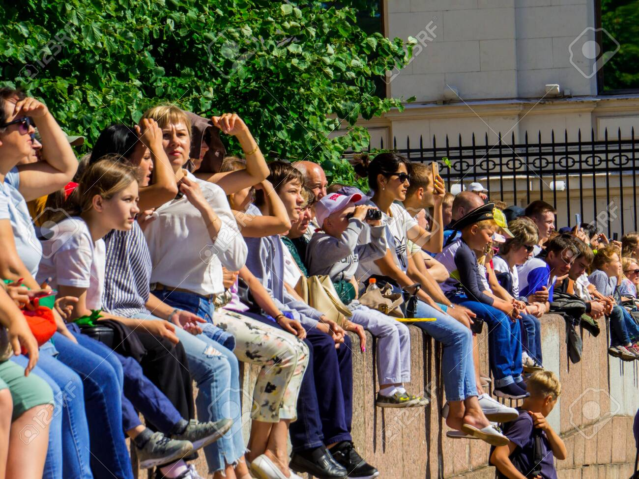 St. Petersburg, Russia - July 26, 2020: People watching the annual celebrations for the Navy Day on the embankment of the Neva River. - 152365084