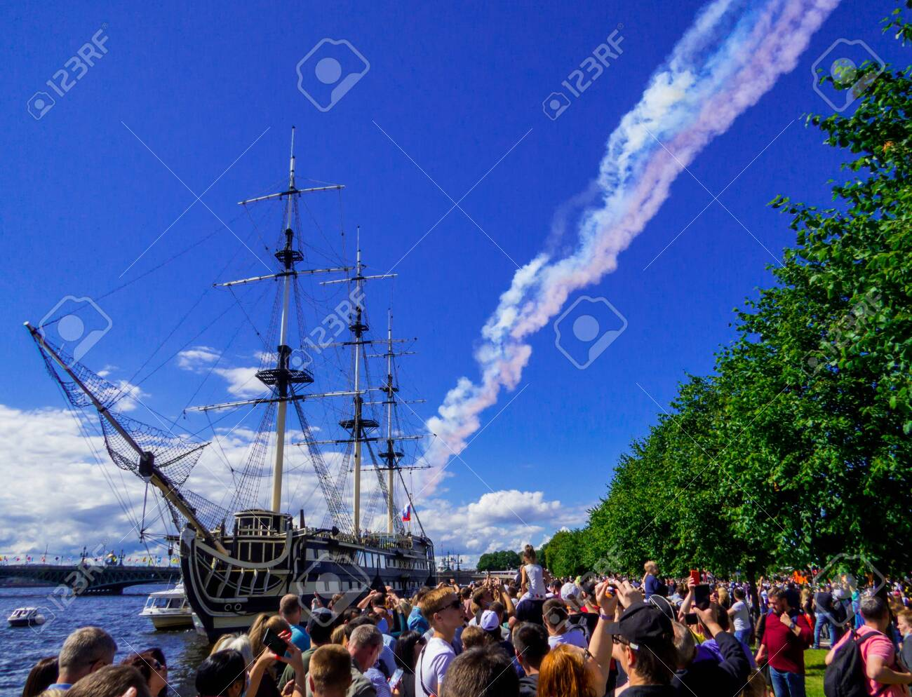 St. Petersburg, Russia - July 26, 2020: People watching the annual celebrations for the Navy Day on the embankment of the Neva River. - 152365069