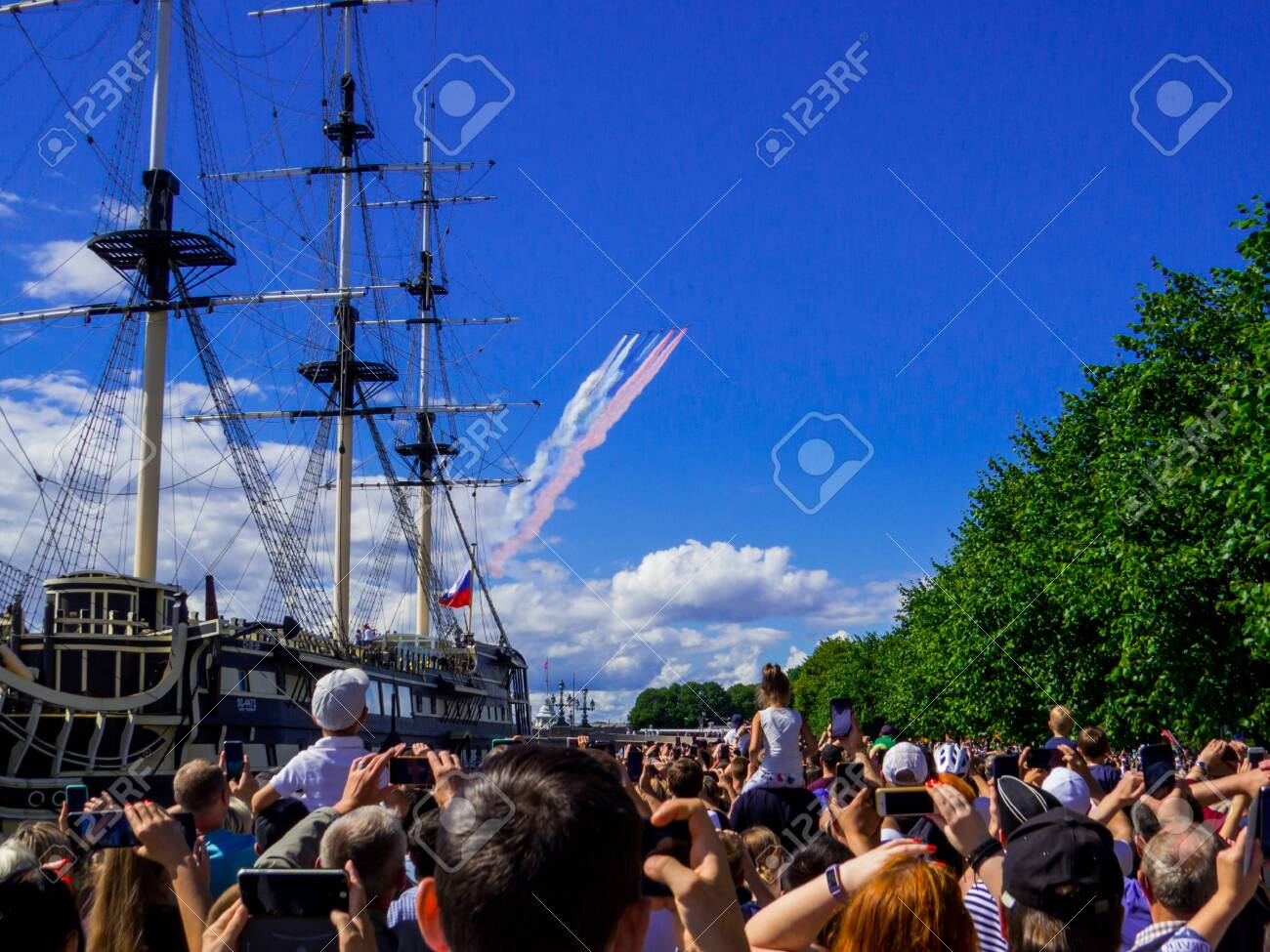 St. Petersburg, Russia - July 26, 2020: People watching the annual celebrations for the Navy Day on the embankment of the Neva River. - 152365072