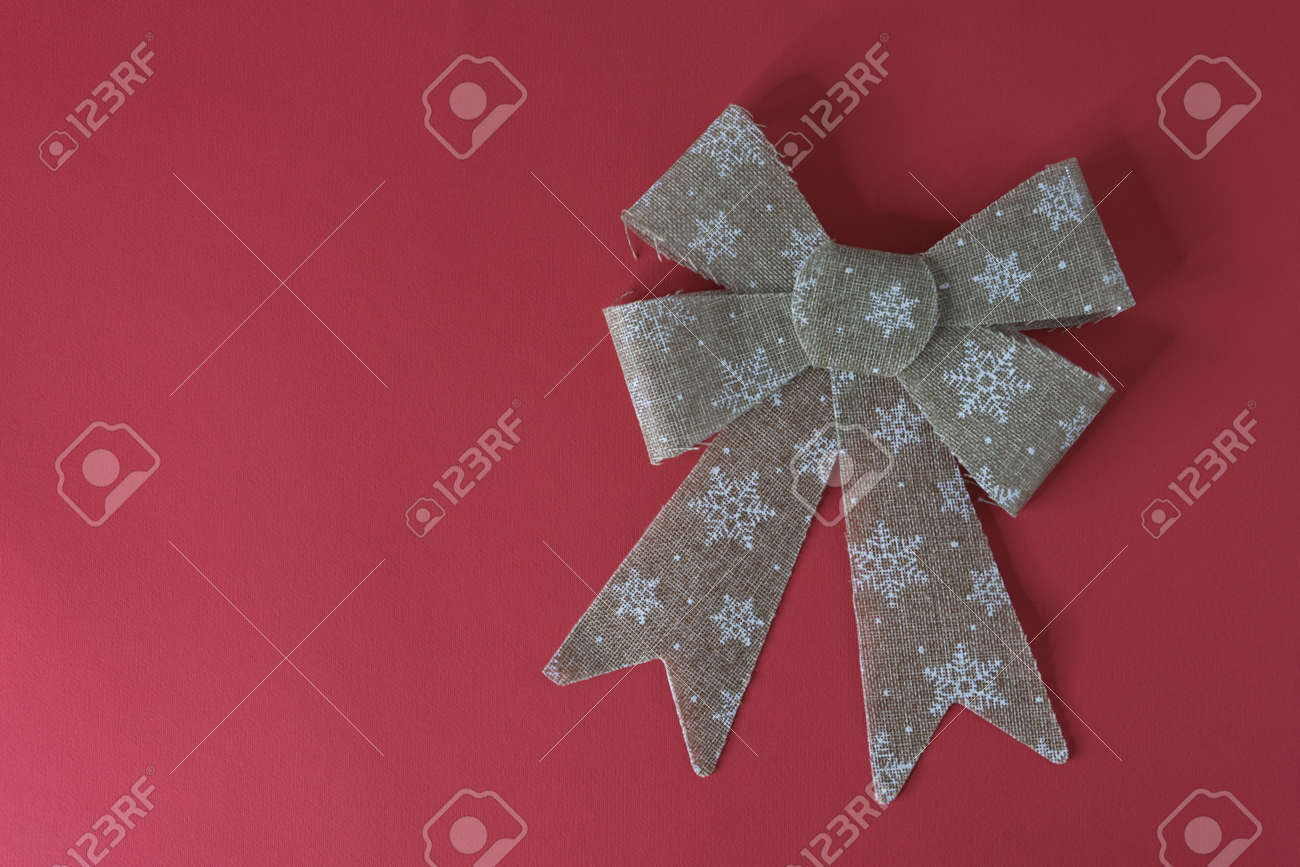 Christmas decoration ribbon gold color and red background - 157483683