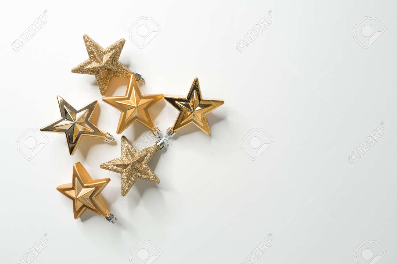 Golden christmas stars on white background - 157609552
