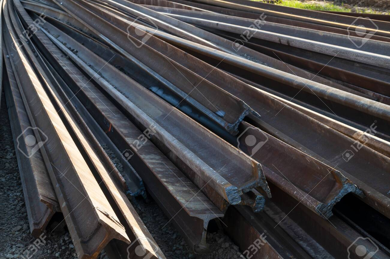Closeup of rails ready to be mounted on the railroad. Railway maintenance works - 141565290
