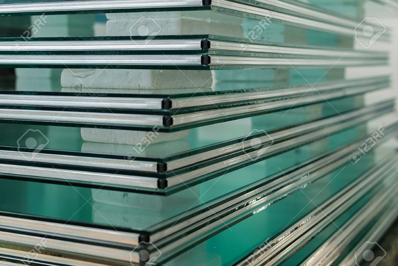 Sheets of Factory manufacturing tempered clear float glass panels cut to  size. Frosted Glass Stock Photos  Royalty Free Frosted Glass Images And