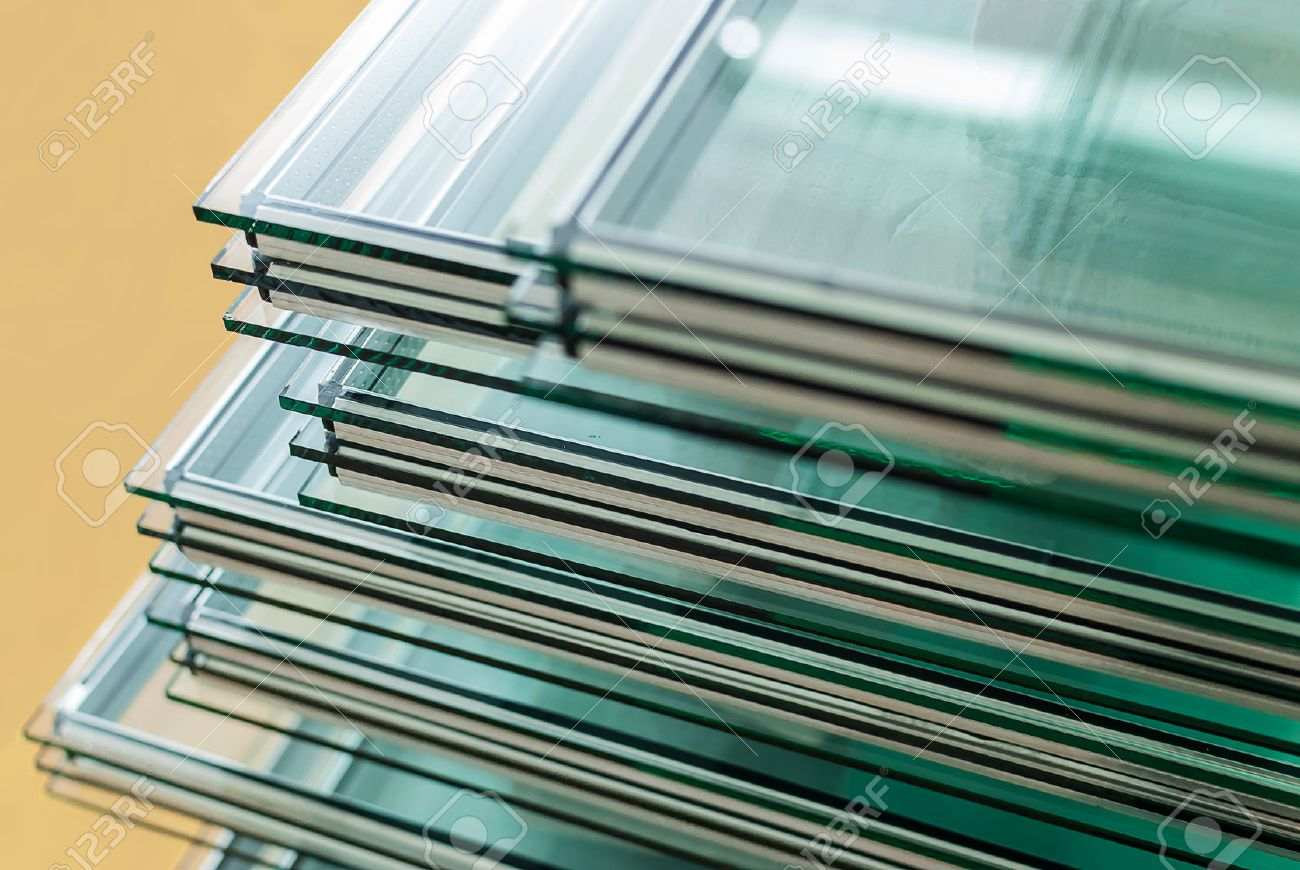 sheets of factory tempered float glass panels cut to size stock photo