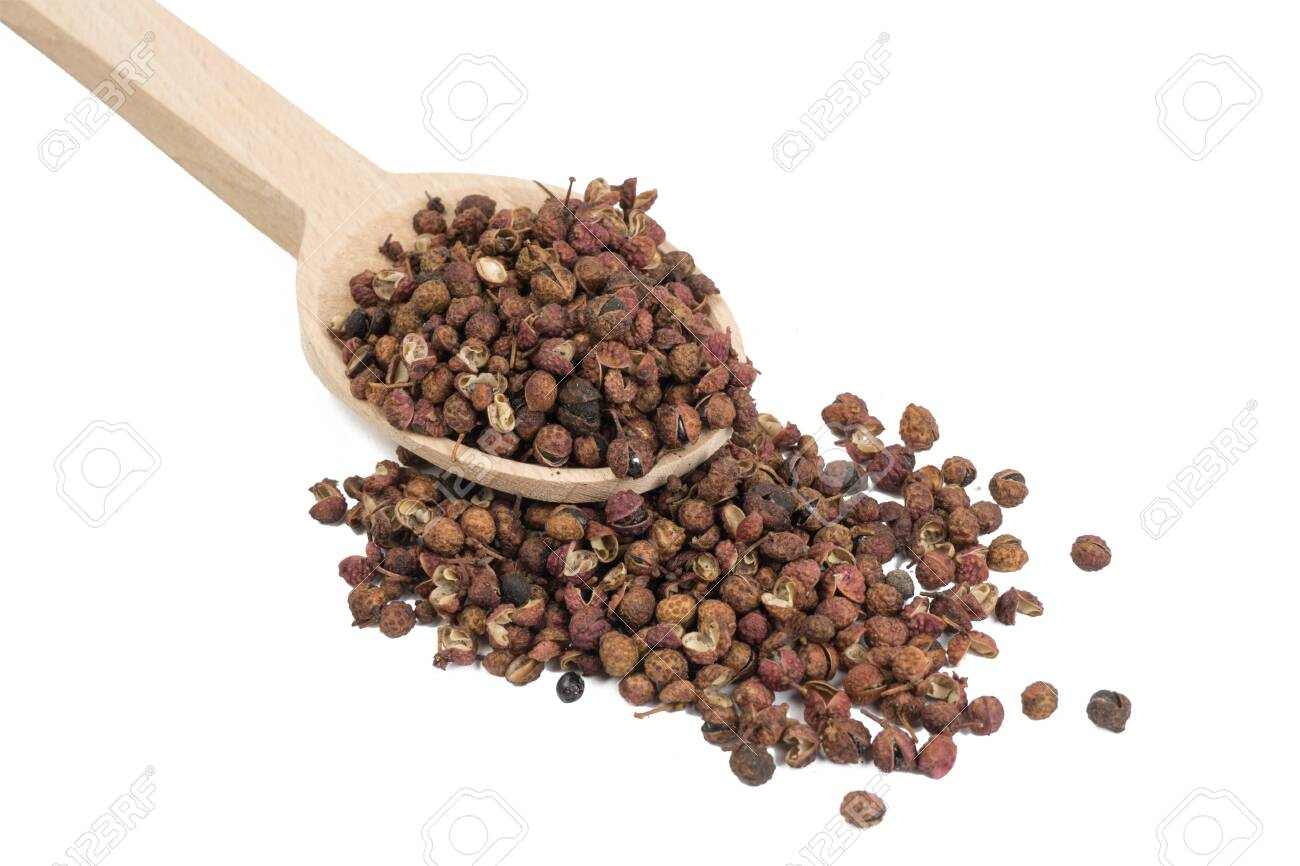 sichuan pepper in wooden spoon isolated on white background. food ingredient. - 137039586