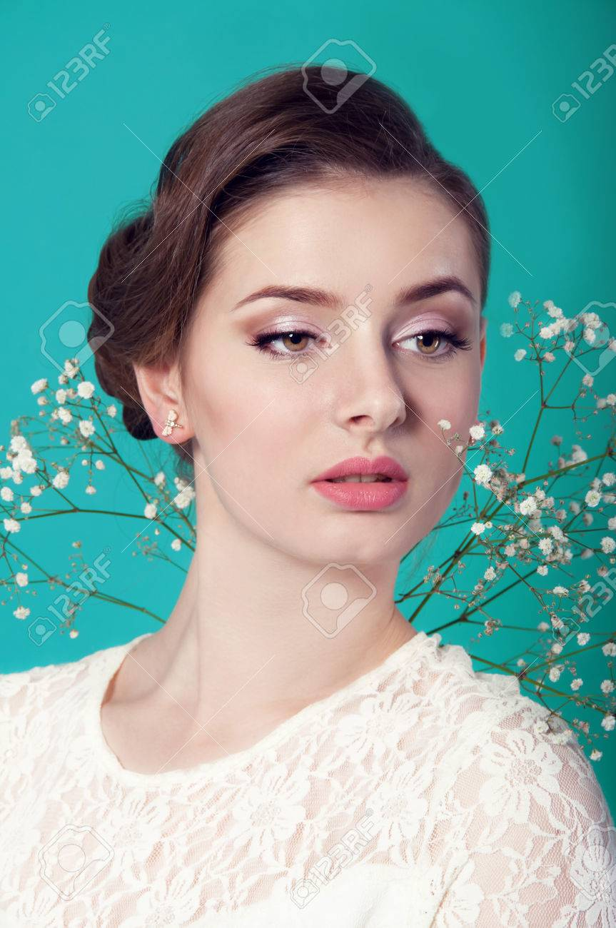 White dress and makeup - Beautiful Woman In White Dress On Turquoise Background Bridal Makeup Stock Photo 36624238