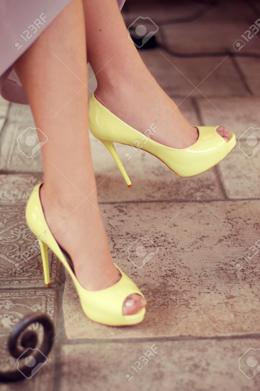 Feminine Legs In Yellow Open-toe Pumps