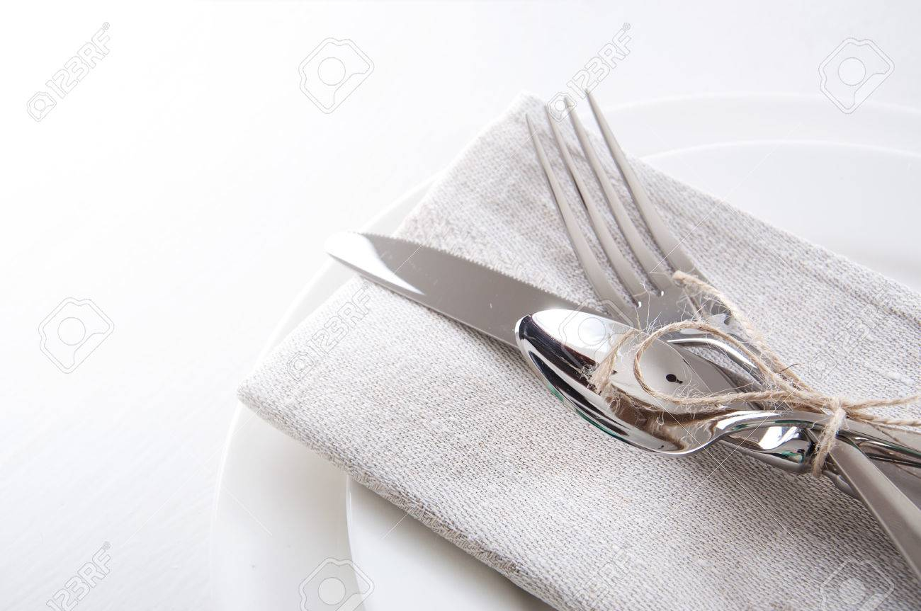 Table Setting In White And Gray Colors With Linen Napkins And ...