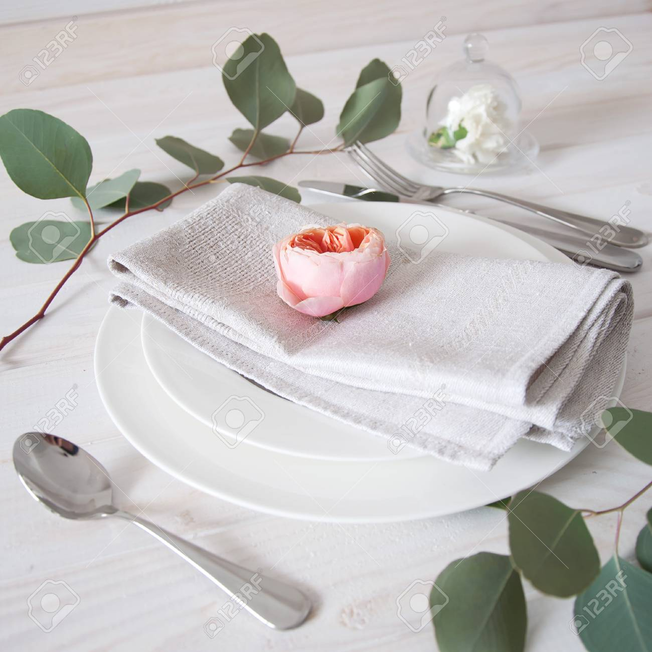 Decorated Table Setting With Gray Linen Napkins Rose And White Stock Photo Picture And Royalty Free Image Image 52444769