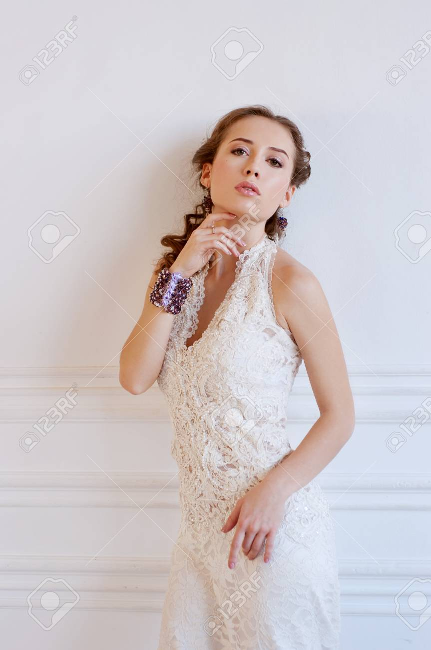 Tender Young Bride With Curly Brown Hair, White Gown And Beaded ...