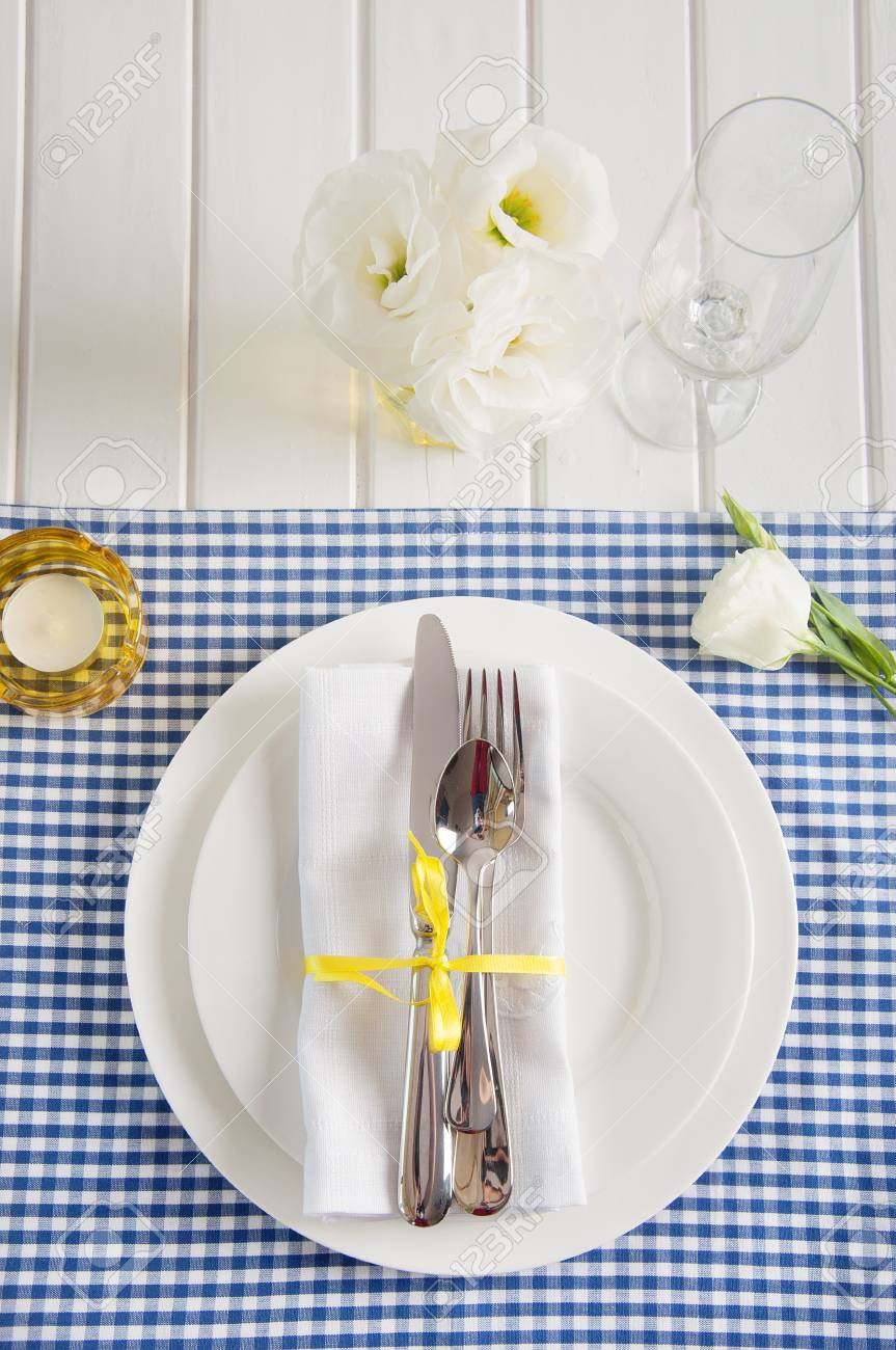 Table Setting With Blue Checkered Tablecloth, White Napkin ...
