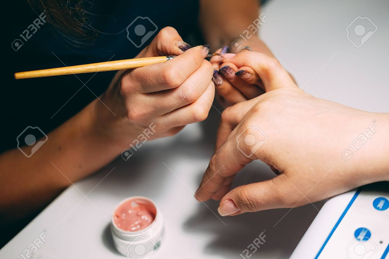 Gel Nail Extensions Build Up Process. Women At Beauty Parlour ...