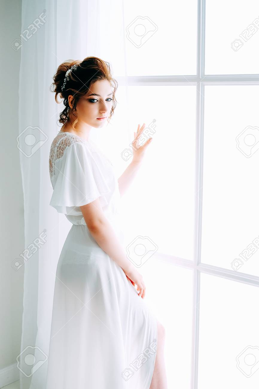 b12e007fa37 Stock Photo - Tender elegant young brunette bride with hairdo