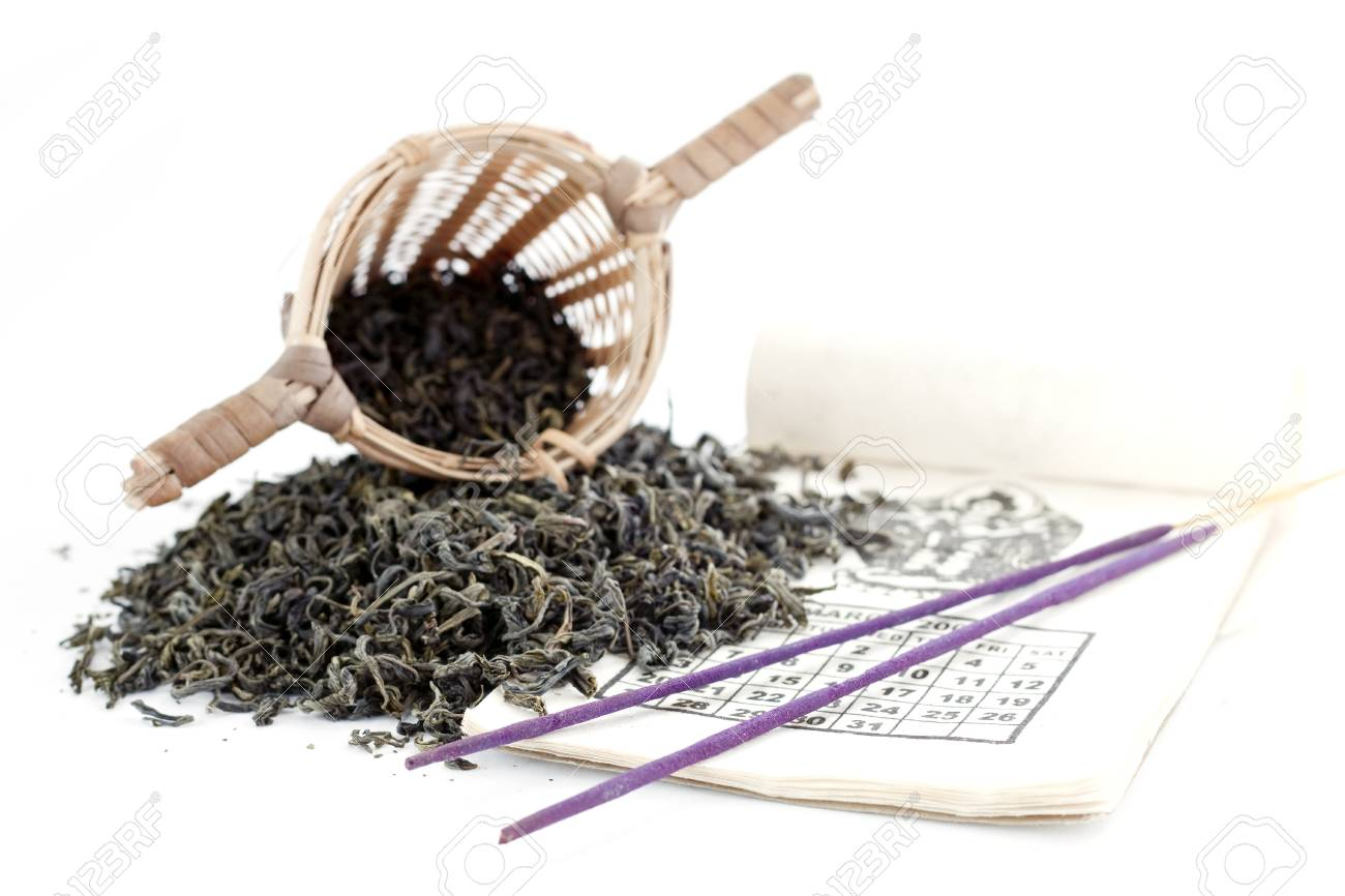 Green tea with sieve isolated on white Stock Photo - 13456455