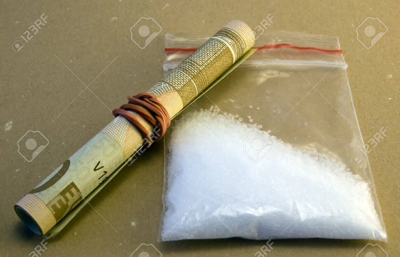 Hard drugs with money on brouwn background Stock Photo - 13456971