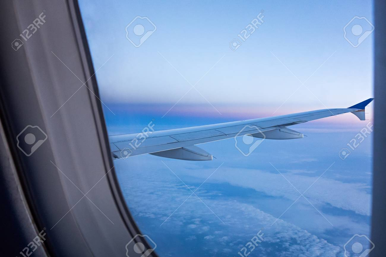 Looking Out Airplane Window In The Morning Stock Photo Picture
