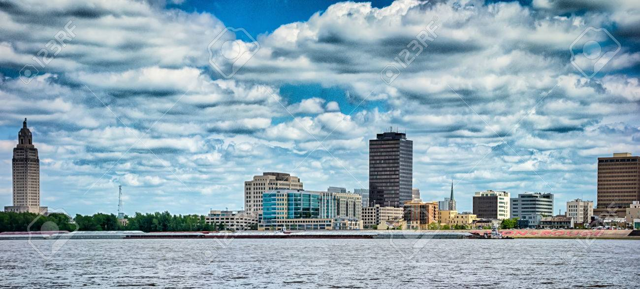 Baton rouge downtown skyline across mississippi river - 83018393