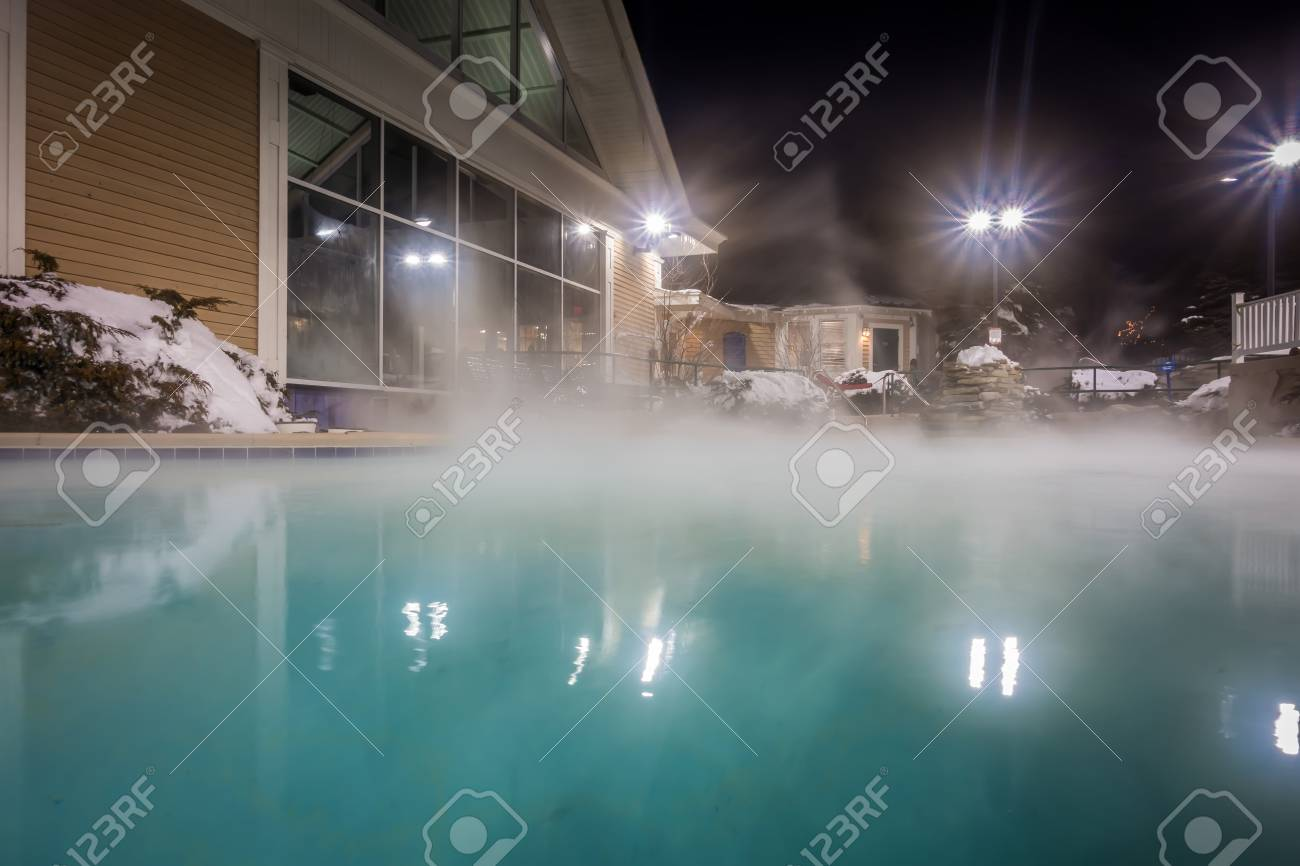 Hot Tubs And Ingound Heated Pool At A Mountain Village In Winter ...