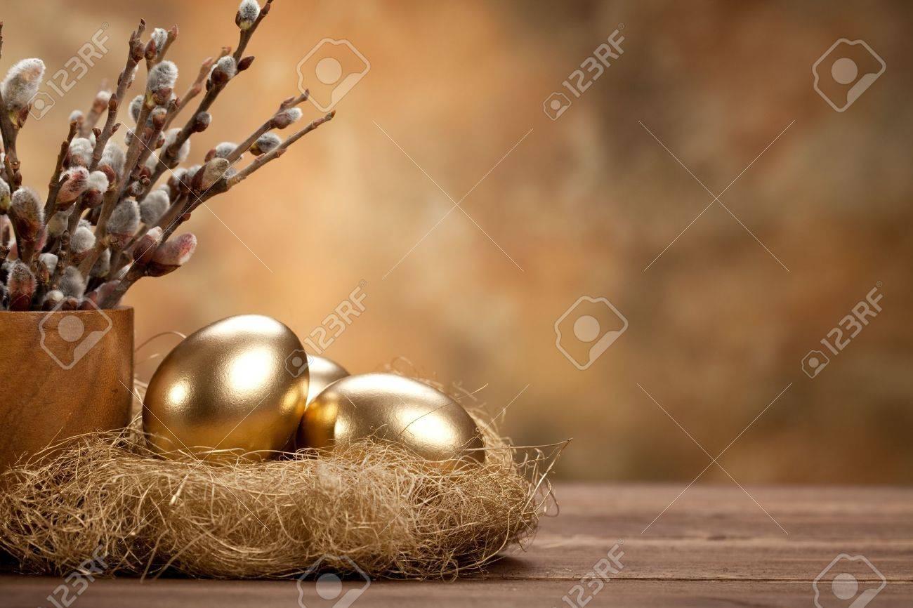 Easter - Golden eggs in the nest Stock Photo - 10528723
