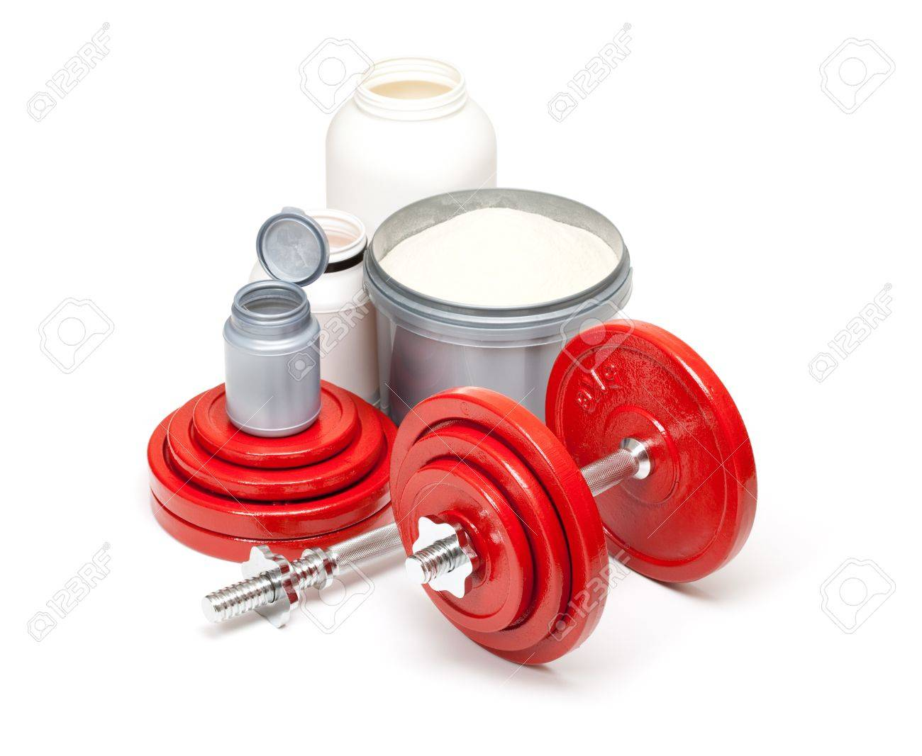 Dumbbells and supplements for body building Stock Photo - 10570504