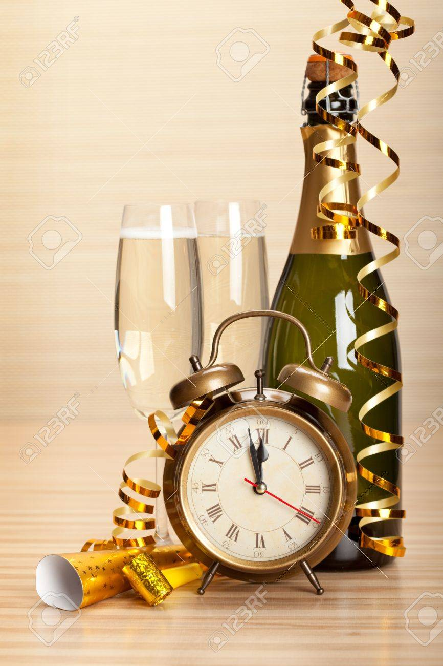 Happy new year - champagne and party decoration Stock Photo - 10570651