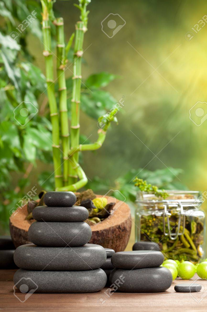Spa treatment - hot stones on bamboo background Stock Photo - 10582744