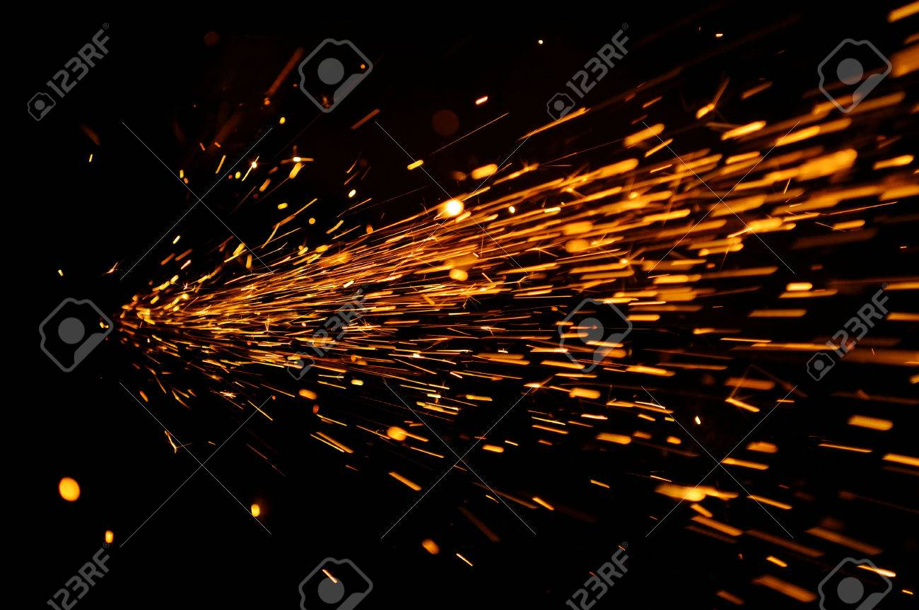 glowing flow of sparks in the dark stock photo picture and royalty