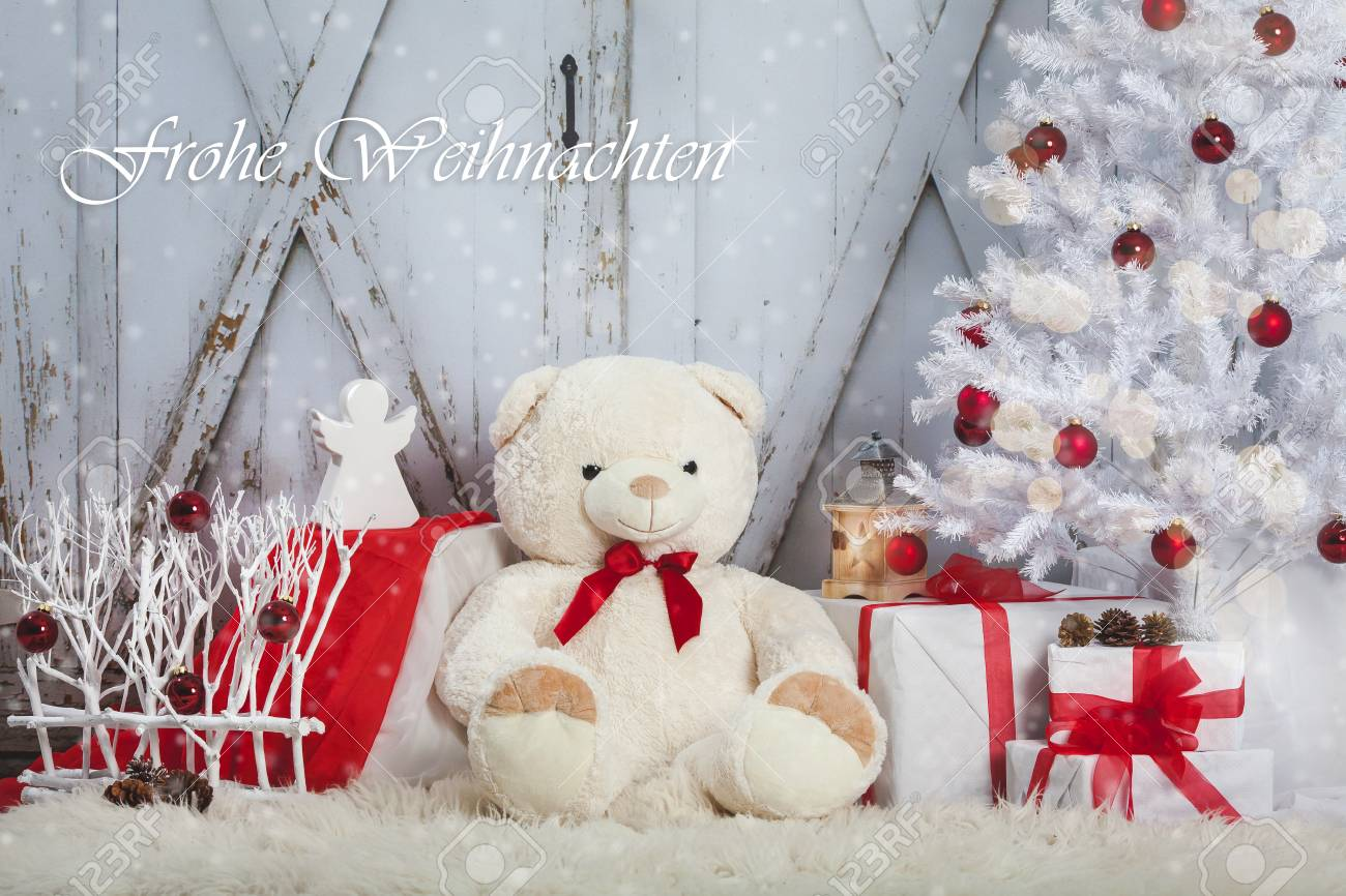 Teddy Bear With An Angel And The Gifts Sitting On Wooden Vintage