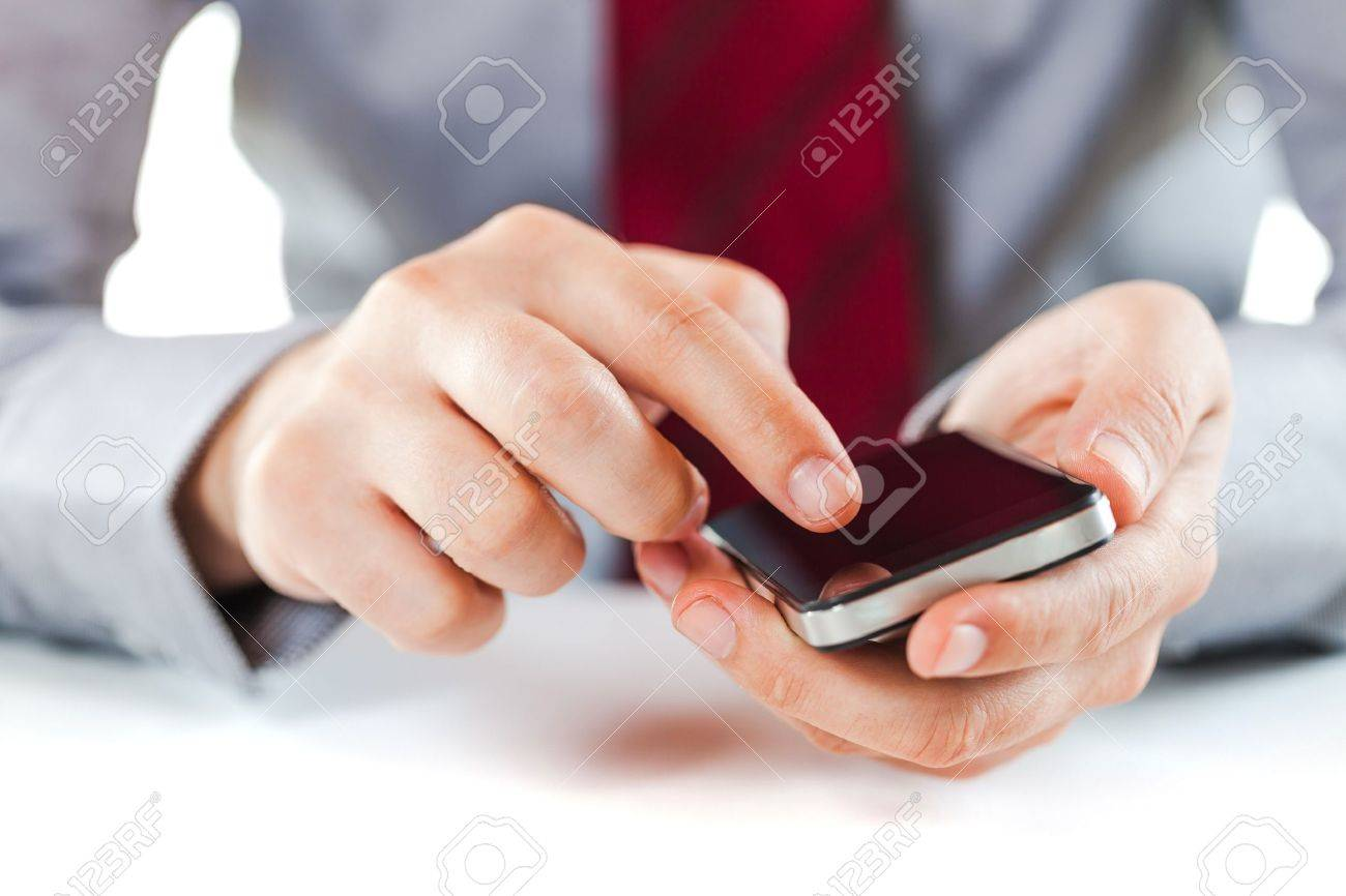close up of a business man using a mobile phone Stock Photo - 15731016