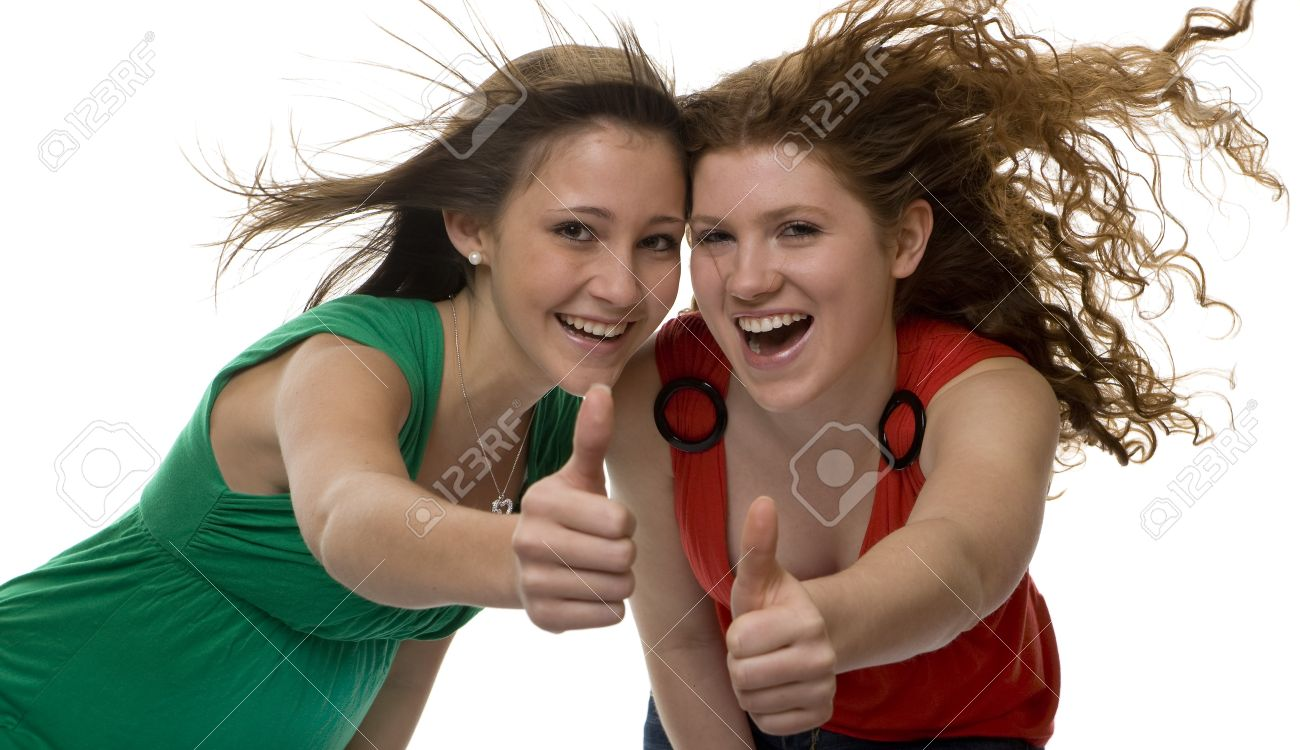 lucky teenagers show joy, two girls with blowing hair Stock Photo - 4406067