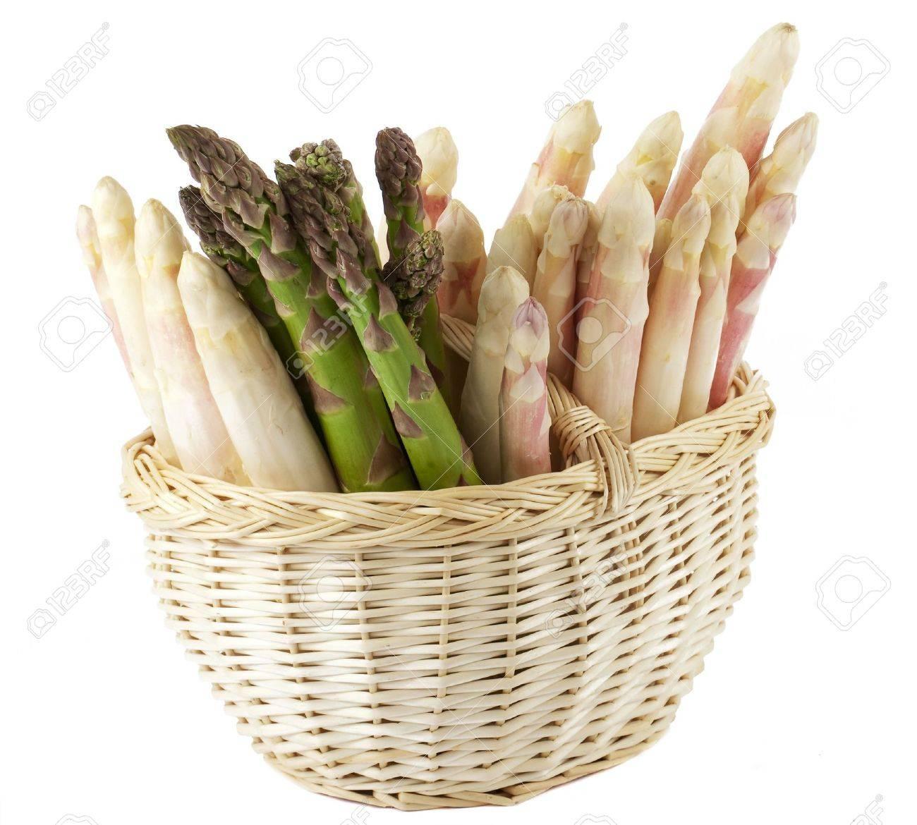 fresh asparagus in basket - 6940756