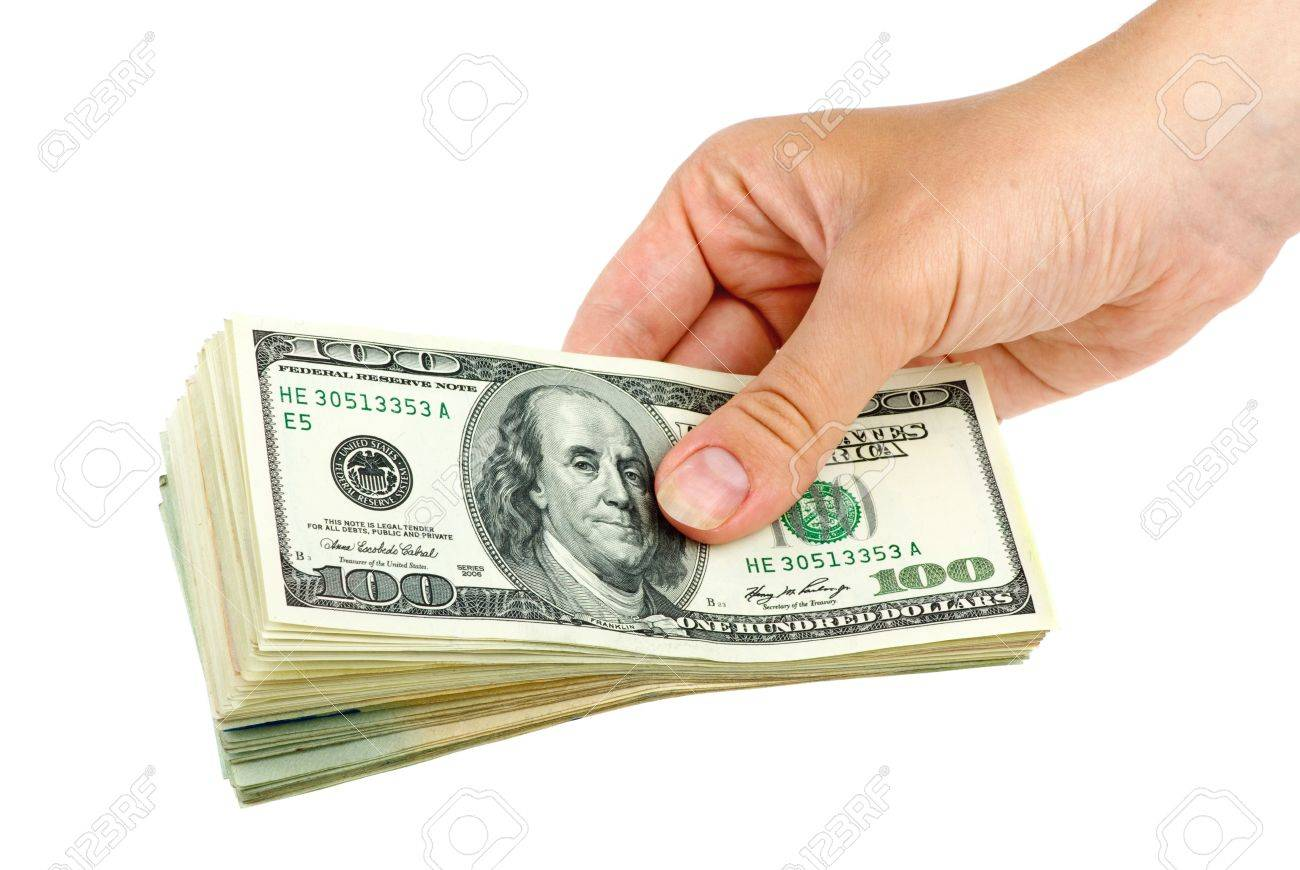 Hand giving pack of $100 banknotes isolated on the white background Stock Photo - 5319763