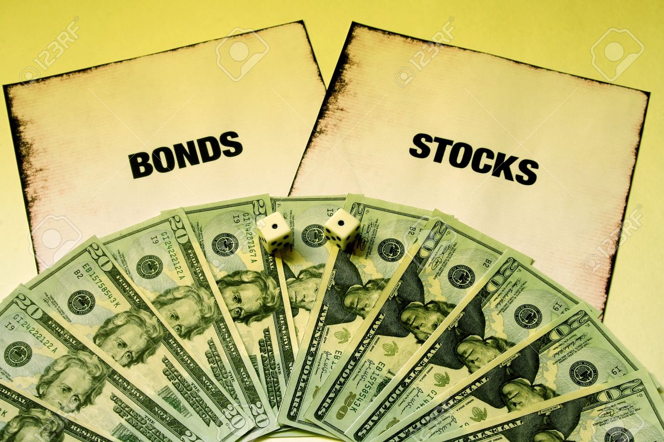 money and dice on stocks and bonds stock photo picture and royalty