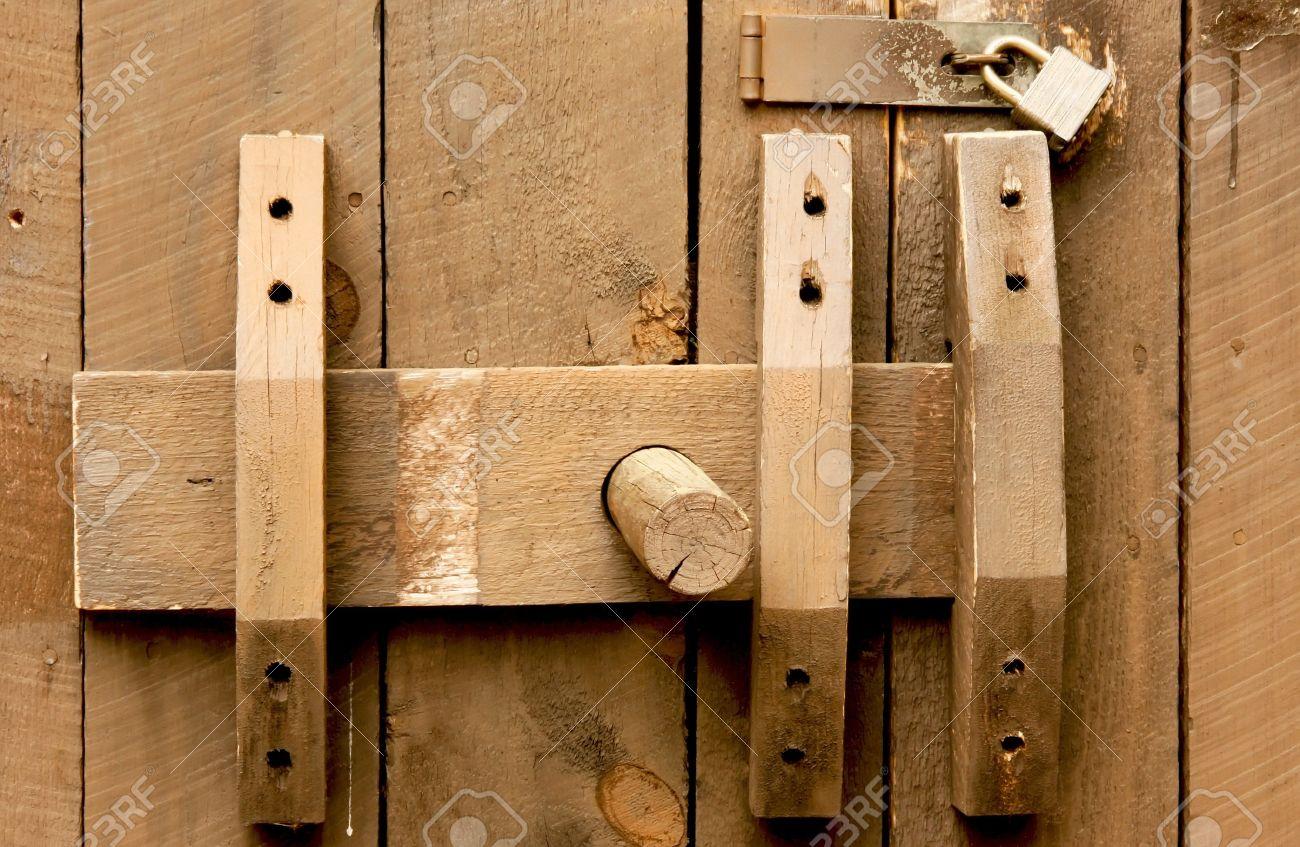 Sliding barn door latches - Old Wooden Door Slide Lock And A Modern Padlock