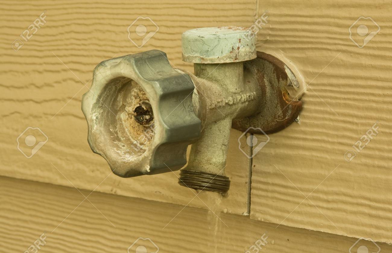 Old Wornout Outside Faucet Leaking And Wasting Water Stock Photo ...