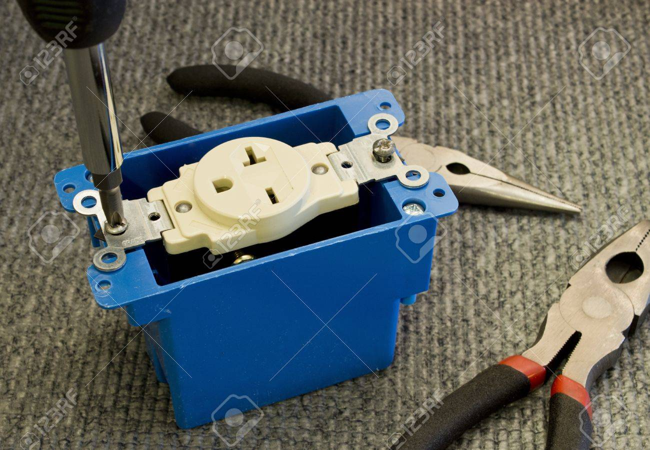 installing a 220 volt outlet into a plastic junction box stock photo Standard Plug Outlet installing a 220 volt outlet into a plastic junction box stock photo 17881412