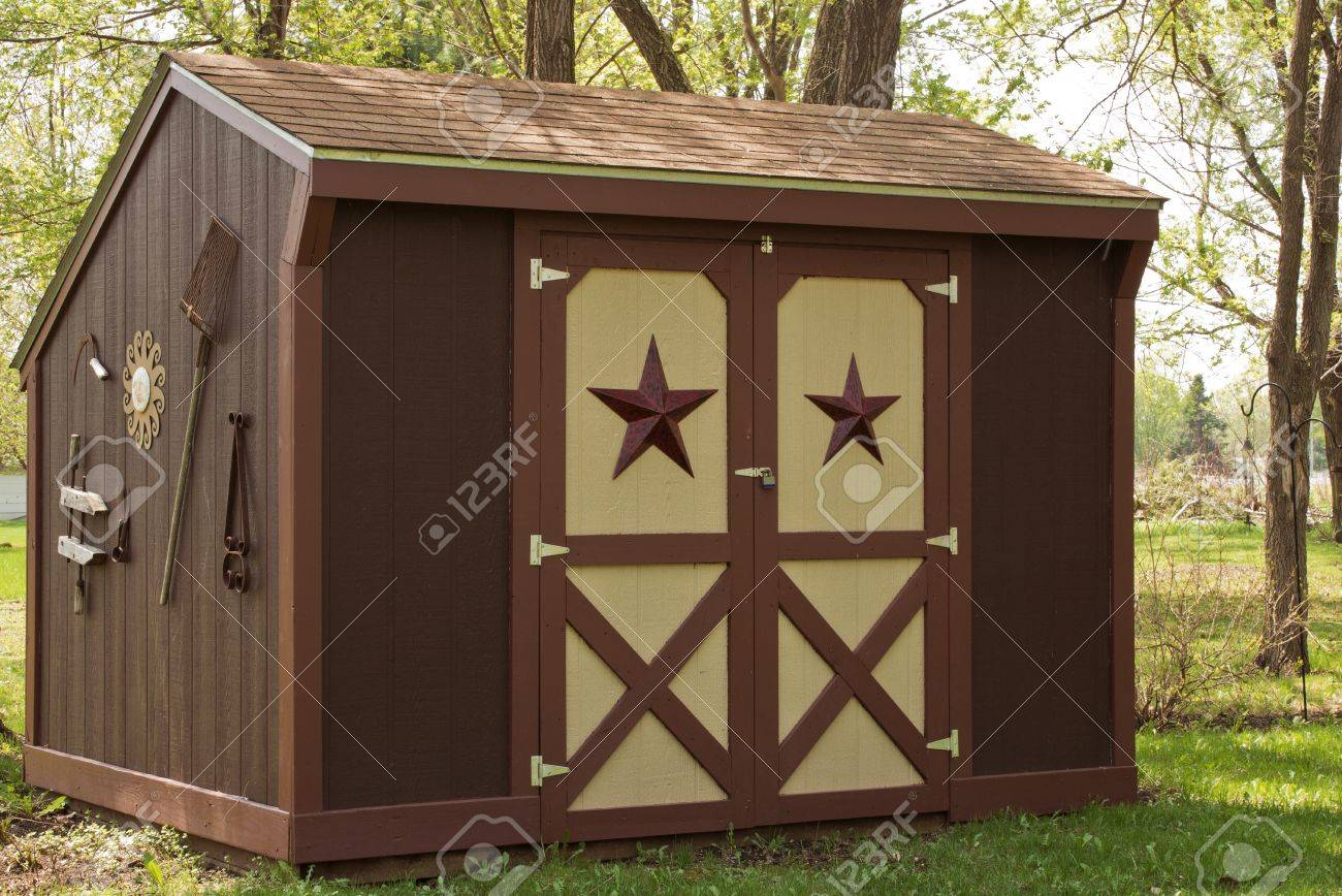 small garden storage shed in a suburban back yard stock photo