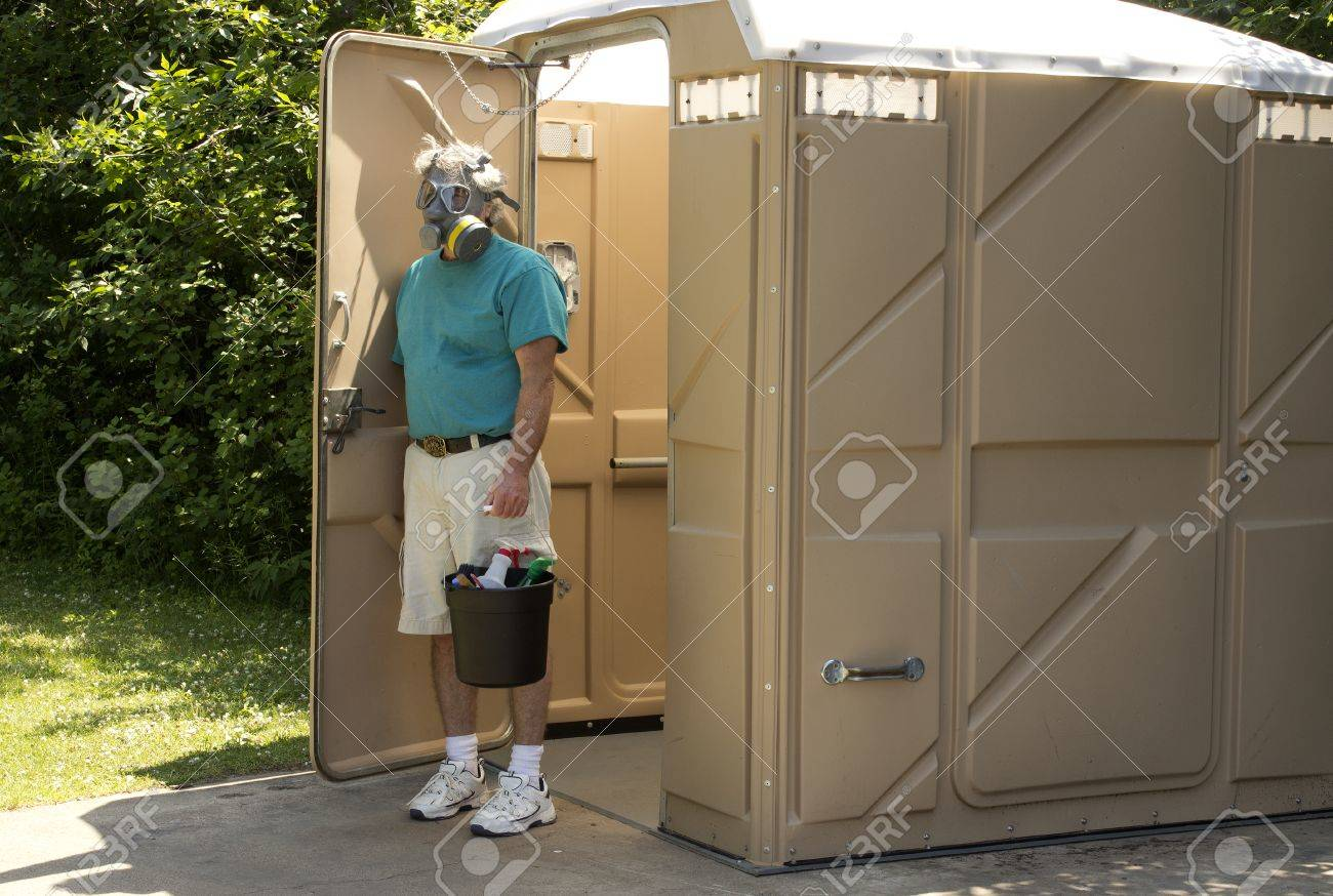 A Maintenance Worker Exits A Foul Smelling Portable Bathroom