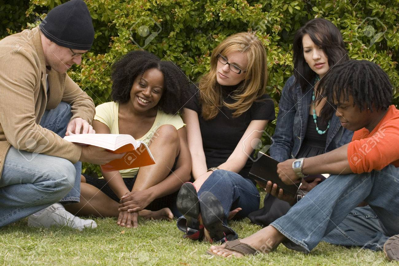 Diverse group of people reading and studying. - 71641643