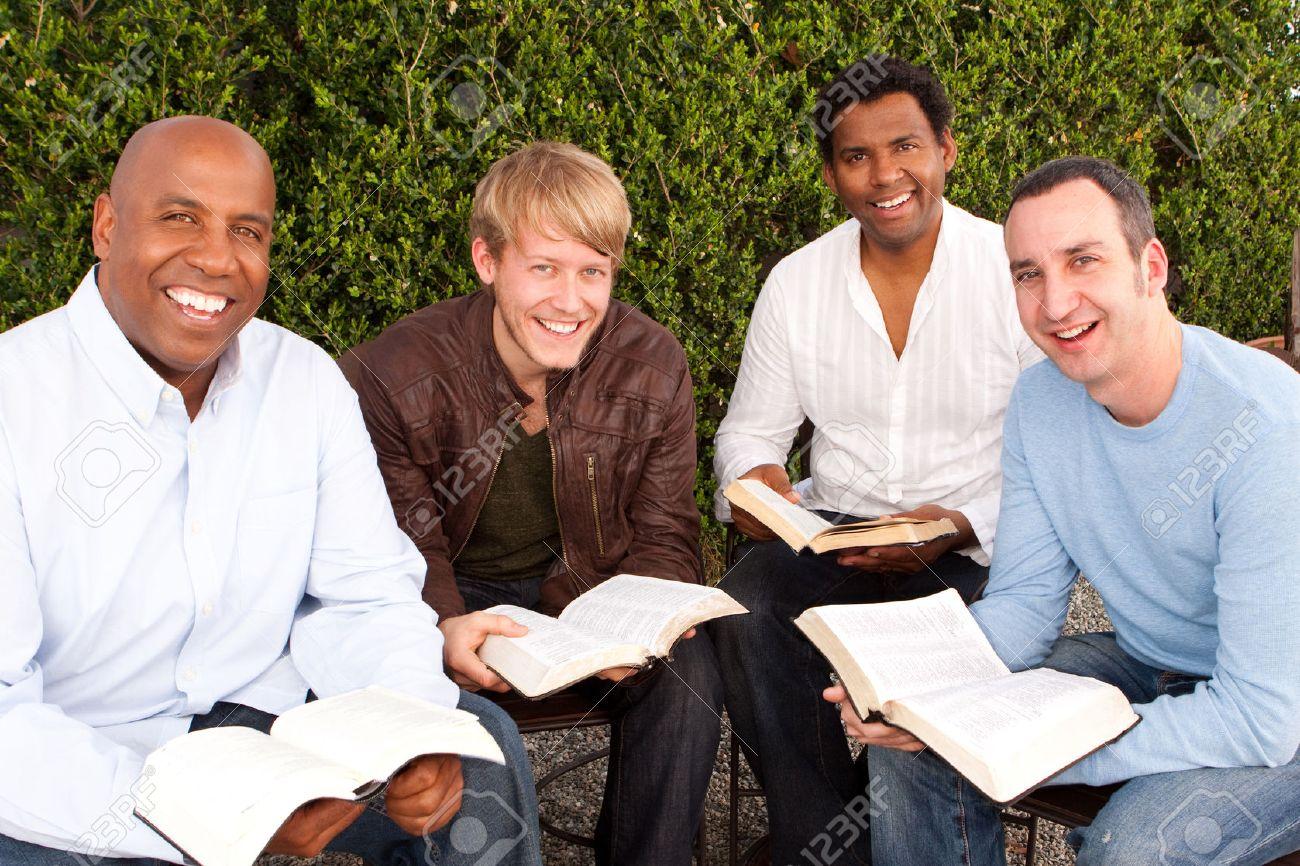 Diverse group of men studying together. - 72659055