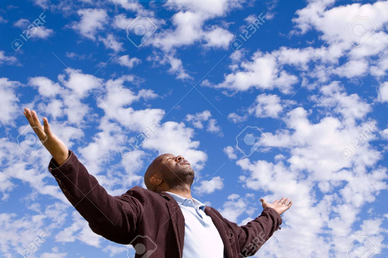 African American man stading outside with open arms. - 74899809