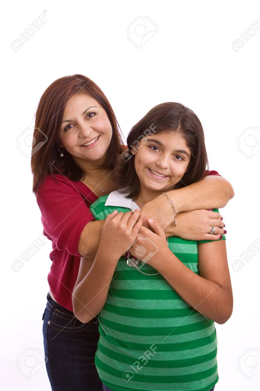 Hispanic mother hugging her daughter isolated on white.. - 110912944