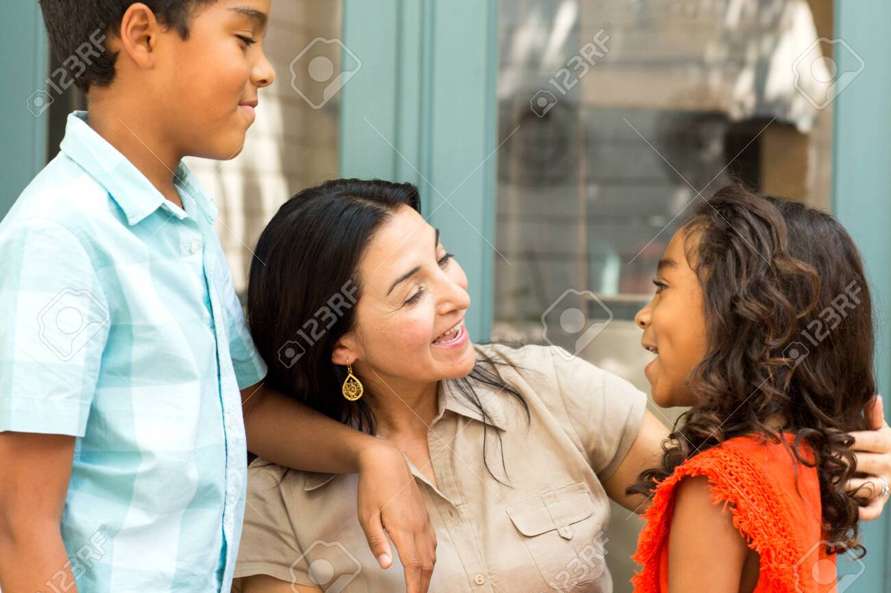 Happy Hispanic mother laughing and talking with her children. - 131151583