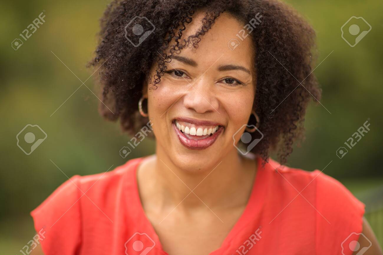Confident Happy African American Woman Smiling Outside - 144305477