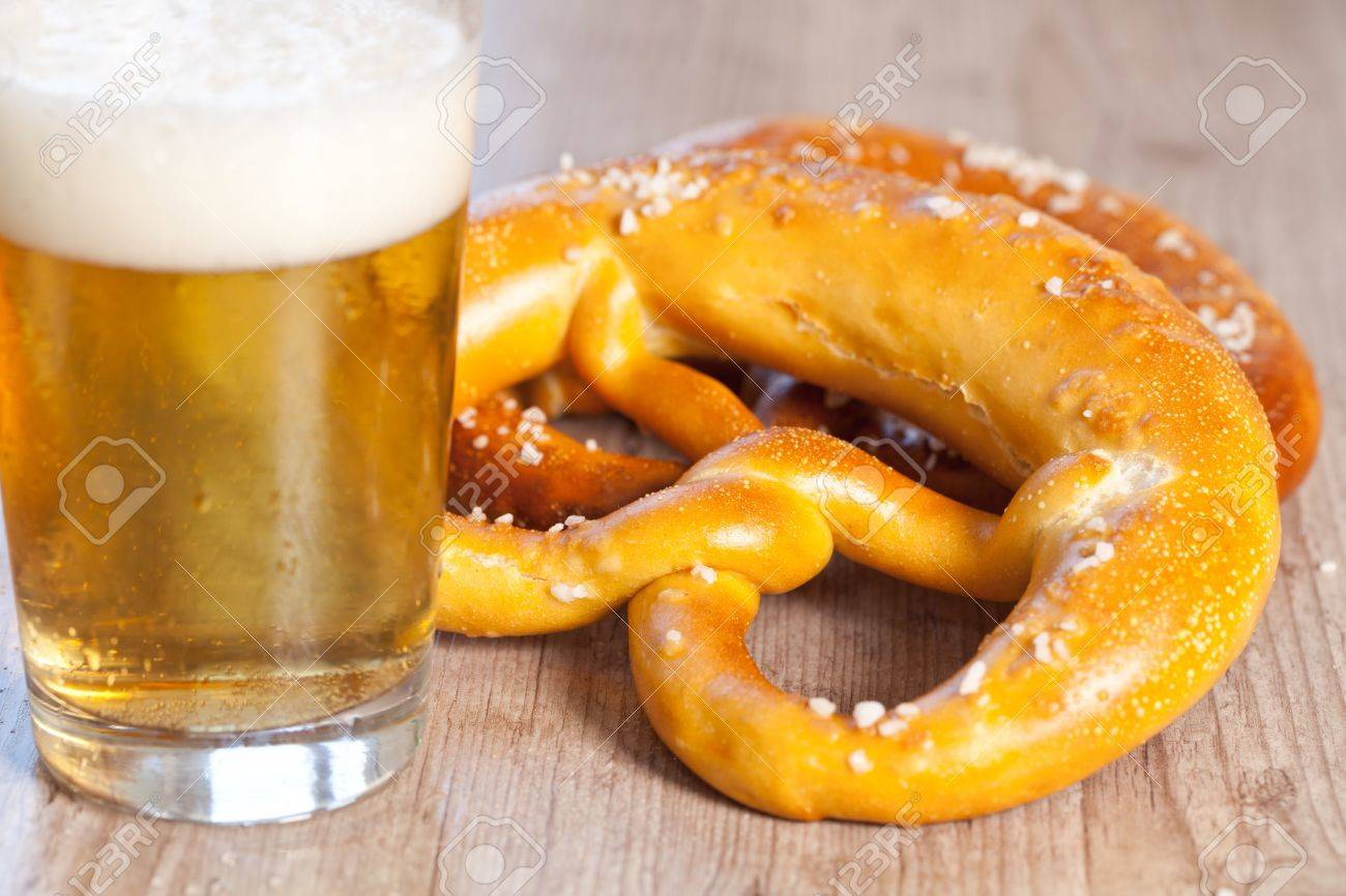 Typical crusty german pretzel bread with beer Stock Photo - 10931968